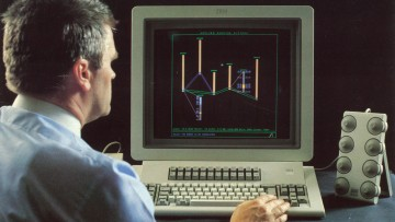 Dr Bob Johnson using an early version of Vulcan mine planning software in 1984